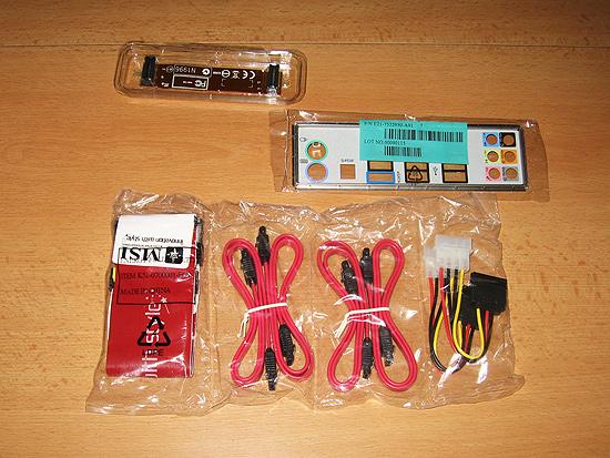 I/O заглушка для задней панели корпуса, CrossFire мостик, кабели SATA и IDE, а также переходники питания с molex на SATA