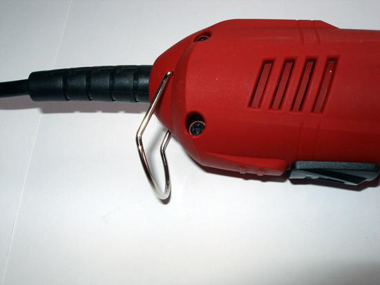Скоба для подвешивания инструмента