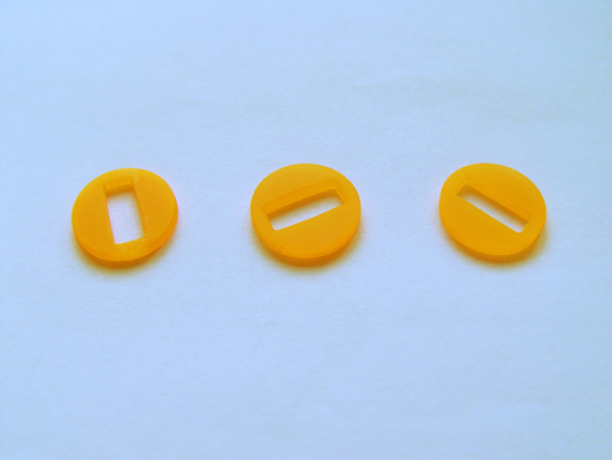 Our three plastic washers with special slots