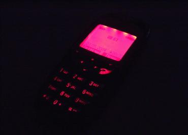 Телефон с новой розовой подсветкой в три четверти
